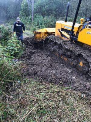 Huge mud hole undergoing repair